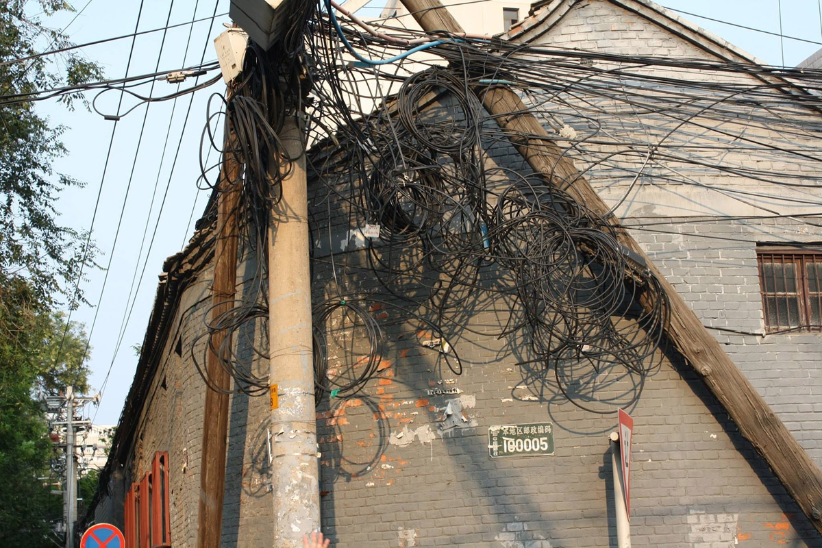 A tangled telephone pole in Beijing