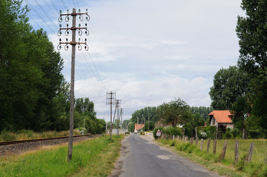 A line of telegraph poles alongside a french railway