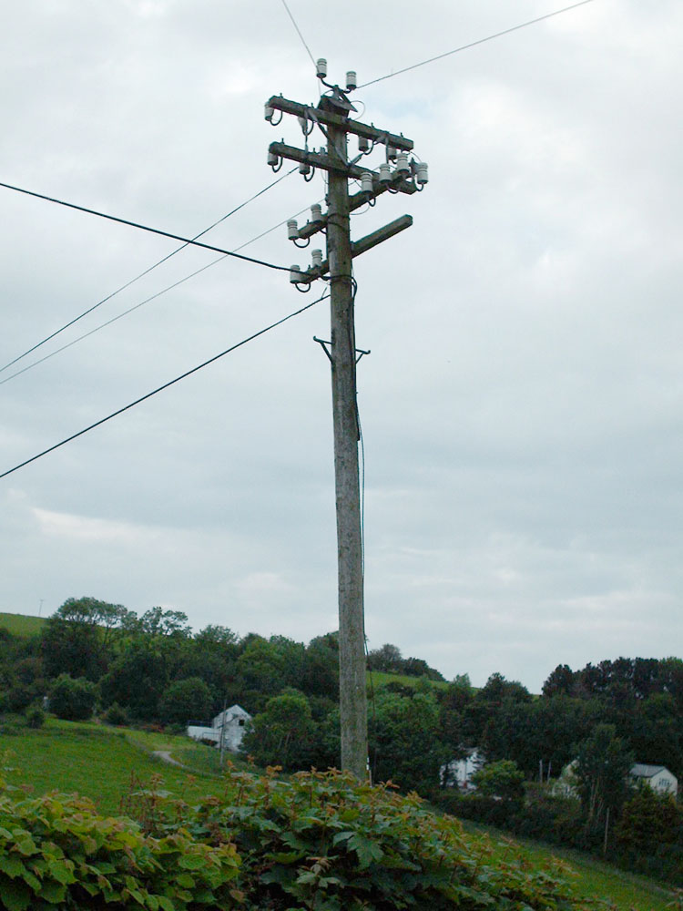 A gorgeous pole with right-angled double crossarms and spindles on the road to the Denbigh Moors