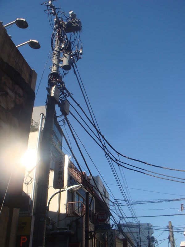 A busy telegraph pole somewhere in Tokyo.