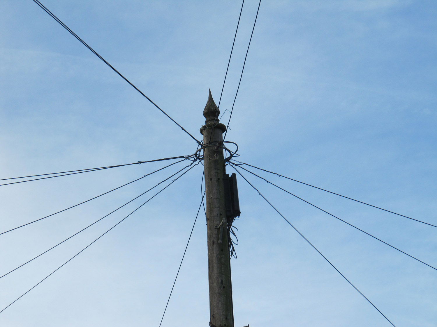 Telephone pole with an ordinary finial on top