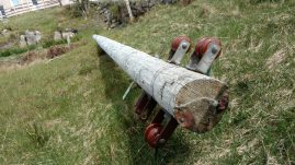 Dead power pole lying down at Tolsta Chaolais, Isle of Lewis.