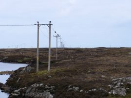 Line of power poles into perspective infinity, Loch Carnan, S. Uist
